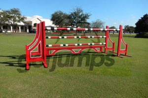 red stripped classic jumper horse jump